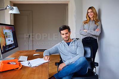Buy stock photo Portrait of a young couple working together in their home office