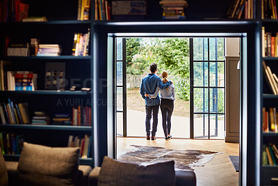 Buy stock photo Rearview shot of a couple looking at the view outdoors from their home