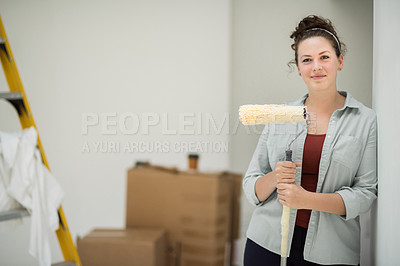 Buy stock photo Cropped portrait of an attractive young woman painting the inside of her home