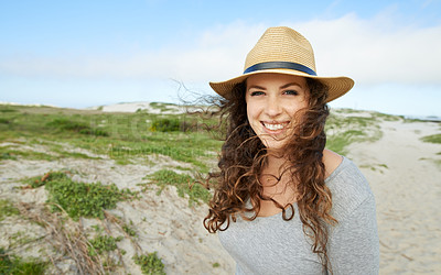 Buy stock photo Portrait of a young woman spending a day at the beach