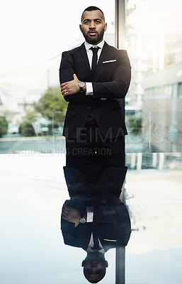 Buy stock photo Cropped portrait of a handsome young businessman standing confidently in a modern office