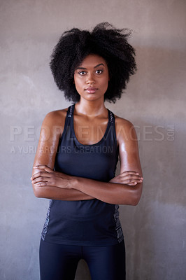 Buy stock photo Cropped portrait of an attractive and athletic young woman standing outside with her arms folded