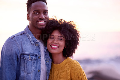 Buy stock photo Portrait of a young attractive couple spending time together at the beach