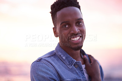 Buy stock photo Portrait of a young handsome man spending the day at the beach