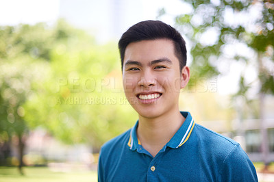Buy stock photo Portrait of a confident young man standing in a park while contemplating outside during the day