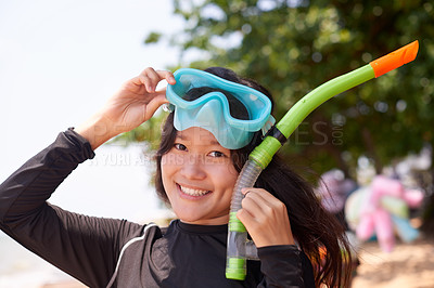 Buy stock photo Cropped portrait of an attractive young woman wearing her snorkelling gear at the beach