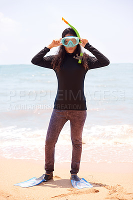 Buy stock photo Full length portrait of an attractive young woman wearing her snorkelling gear at the beach