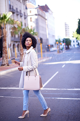 Buy stock photo Full length shot of an attractive and fashionable young woman drinking coffee while walking in the city
