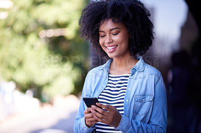 Buy stock photo Shot of a young designer using a cellphone outside an office