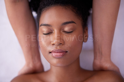 Buy stock photo Shot of a young woman getting  a back massage at a spa