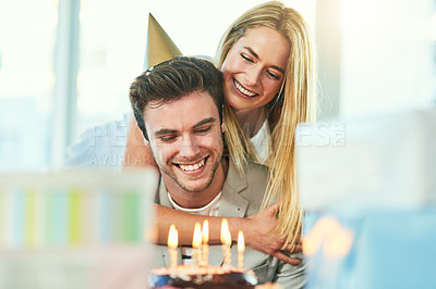 Buy stock photo Cropped shot of a handsome young man celebrating his birthday with his girlfriend