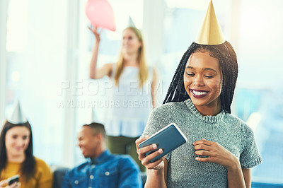 Buy stock photo Cropped shot of an attractive young woman taking selfies while celebrating a birthday with her friends