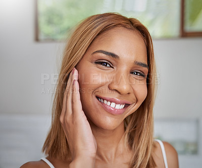 Buy stock photo Portrait of an attractive young woman feeling her soft skin in the bathroom at home