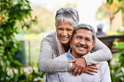 Buy stock photo Portrait of a mature couple spending quality time together at the park