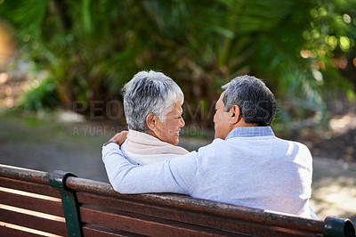 Buy stock photo Rearview shot of a mature couple spending quality time together at the park