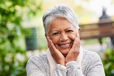 Buy stock photo Portrait of a mature woman touching her face outdoors