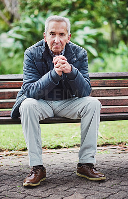 Buy stock photo Portrait of a senior man sitting on a park bench