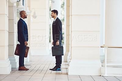 Buy stock photo Shot of two businessmen talking in the city
