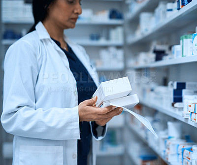 Buy stock photo Cropped shot of a pharmacist filling a prescription at a chemist