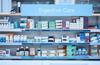 Buy stock photo Shot of shelves stocked with various medicinal products in a pharmacy