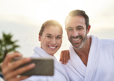 Buy stock photo Cropped shot of a couple taking a selfie while at a spa