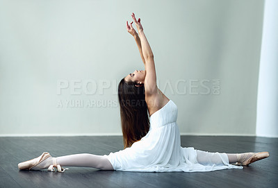 Buy stock photo Full length shot of an attractive young female ballerina practicing in her dance studio