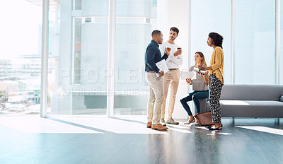 Buy stock photo Full length shot of a group of creative colleagues working together in their modern office
