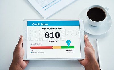 Buy stock photo Shot of an unrecognizable businesswoman holding a digital tablet showing her credit score