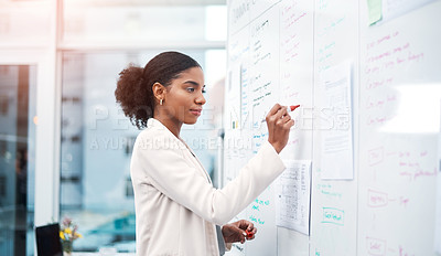 Buy stock photo Shot of a young businesswoman brainstorming on a whiteboard in modern office