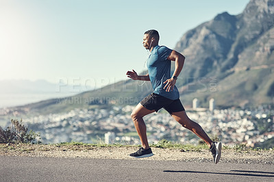 Buy stock photo Shot of a young handsome man running outdoors