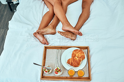 Buy stock photo Shot of a couple having breakfast in bed