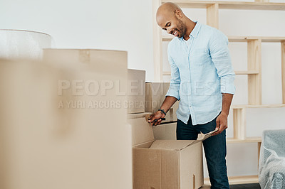 Buy stock photo Shot of a young man moving house