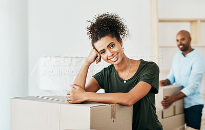 Buy stock photo Portrait of a young couple moving house