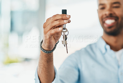 Buy stock photo Shot of a young man holding the keys to his new home