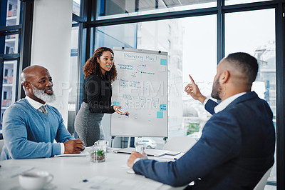 Buy stock photo Shot of a young businesswoman giving a presentation to her colleagues in an office