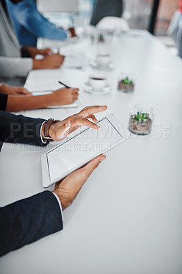 Buy stock photo Closeup shot of an unrecognizable businessman using a digital tablet during a meeting in an office