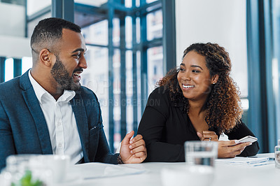 Buy stock photo Shot of two businesspeople having a meeting in an office
