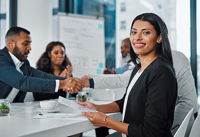 Buy stock photo Portrait of a young businesswoman using a digital tablet during a meeting in an office