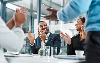 Buy stock photo Shot of a group of businesspeople applauding during a meeting in an office