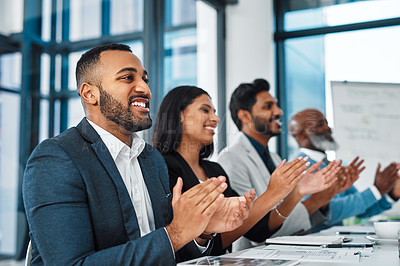 Buy stock photo Shot of a panel of businesspeople applauding during a presentation in an office