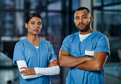 Buy stock photo Portrait of two medical practitioners standing in a hospital at night