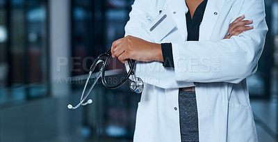 Buy stock photo Closeup shot of an unrecognizable doctor standing in a hospital at night
