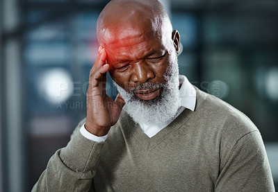 Buy stock photo Shot of a senior man suffering with a headache highlighted in glowing red