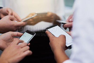 Buy stock photo Closeup shot of a group of businesspeople using their cellphones in synchronicity in an office