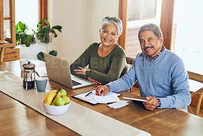 Buy stock photo Portrait of a mature couple managing their paperwork together at home
