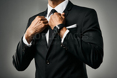 Buy stock photo Studio shot of a stylish unrecognizable businessman against a gray background