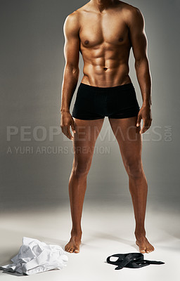 Buy stock photo Studio shot of a sexy unrecognizable man against a gray background in his underwear