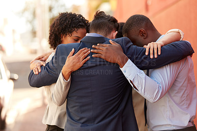 Buy stock photo Shot of a group of businesspeople standing together in a huddle outdoors