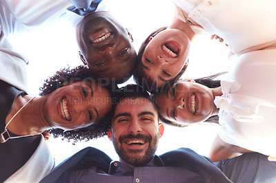 Buy stock photo Portrait of a group of businesspeople joining their heads together in a huddle outdoors