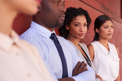 Buy stock photo Portrait of a young businesswoman standing amongst her colleagues outdoors